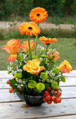 Beautiful bouquet in orange tones — Stock Photo