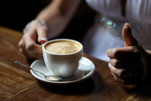 Bride's hands holding cup of coffe — Stock Photo