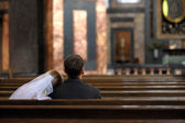 Bride and groom in the church — Stockfoto