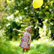 Little baby girl with a yellow balloon — Stock Photo #3120018