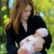 Young mother holding newborn baby - Stock Photo