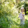 Little baby in a summer forest - Stock Photo