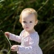 Little baby iin a meadow - Stock Photo