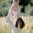 Young mother holding her baby — Stock Photo #3120060