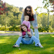Young family in a park — Stock Photo