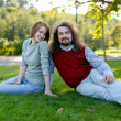 Young couple sitting on grass in park — Stock Photo #3120124