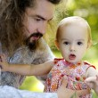 Young father holding his baby girl - Stock Photo