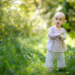 Little baby in forest with maples leaves — Stock Photo