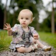 Little upset baby on the park alley — Stock Photo #3120225