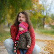 Father and his baby in autumn park — Stock Photo #3120249