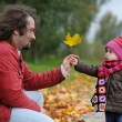 Father and his baby girl in autumn park — Stock Photo #3120285