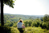 Little baby girl and her father on the edge of a — Stock Photo