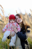 Young mother and her baby — Stock Photo