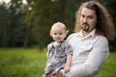 Young father holding his baby girl — Stock Photo
