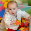 Pretty little girl in toy box — Stock Photo #3140123