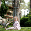 Little baby sitting on the grass — Stock Photo