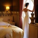 Bridestanding agains the window — Stock Photo