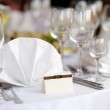 Place card on the white festive table — Stock Photo #3140187