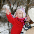 Little winter baby girl and her young mother — Stockfoto