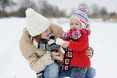 Little winter baby girl and her mother — Stock Photo
