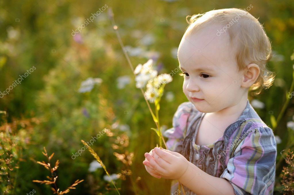 Little nice sweet baby walking in a meadow — Stock Photo #3140149