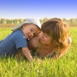 Mother and her son on the grass — Stock Photo