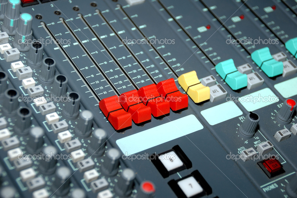 Audio mixing console in a recording studio. Faders and knobs of a sound mixer. — Stock Photo #2956399