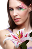 Girl with tiger lily — Stock Photo
