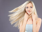 Girl with fluttering hair — Stock Photo