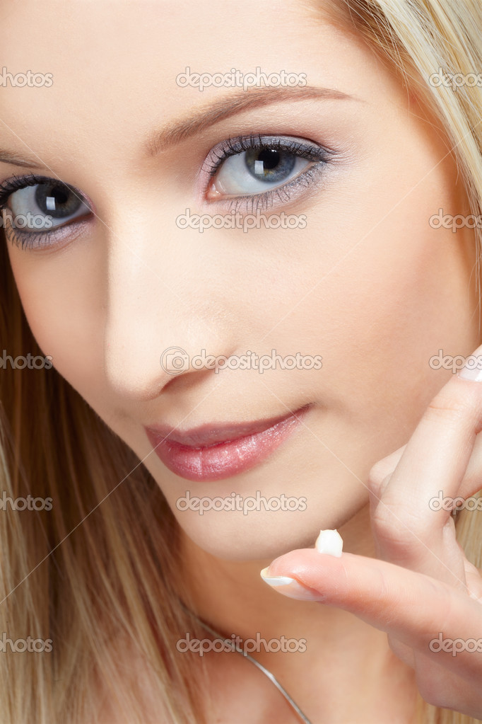 Closeup portrait of beautiful slavonic blonde girl with a drop of cream on her finger  Stock Photo #2775861