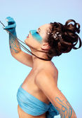 Girl's fantasy blue body-art — Stock Photo