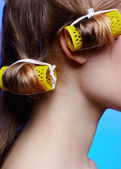 Girl with hair rollers — Stock Photo