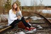 Girl on rail — Stockfoto