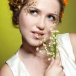 Girl with may lily flowers — Stock Photo