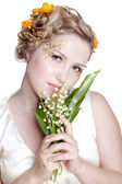 Girl with may lily flowers — Stockfoto