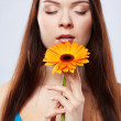Stock Photo: Beautiful girl with gerbera