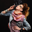 Royalty-Free Stock Photo: Glam punk girl smoking