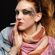 Glam punk girl smoking - Stockfoto