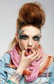 Wriggling glam punk girl — Stock Photo