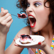 Girl eating cake - Stock Photo