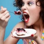Girl eating cake — Stock Photo