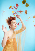 Girl and autumn leaves — Stock Photo