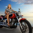 Stock Photo: Blonde and red motorcycle