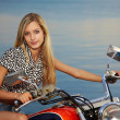 Blonde on red chopper — Stock Photo