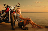 Blonde and red motorcycle — Stock Photo