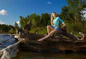 Blonde posing near flotsam — Stock Photo