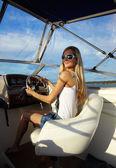 Blonde at steering wheel — Stock Photo