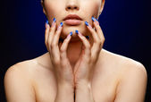 Girl with blue manicure — Stock Photo