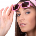 Model in pink sun-glasses — Stock Photo