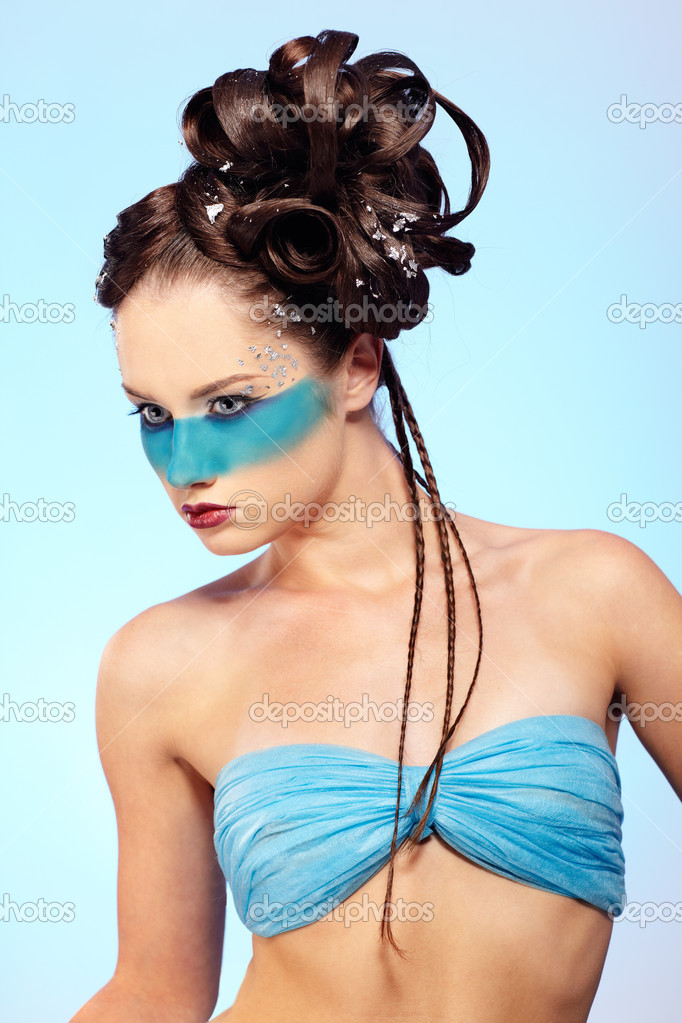 Portrait of beautiful girl with blue stripe facial bodyart and fantasy hair-do with several thin braids — Stock Photo #4047360